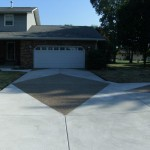 driveway and two story house