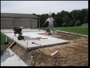 Laying Concrete and Construction Worker
